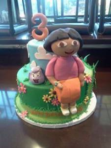 Dora the Explorer, two tier cake, birthday cake, custom cake, fondant cake, cartoon cake, kids cake, denver colorado, figurine cake